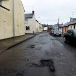 Buche sulla strada: che fare per ottenere il risarcimento dei danni?